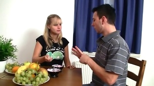 Breasty blond minx bows over the table and gets drilled hard